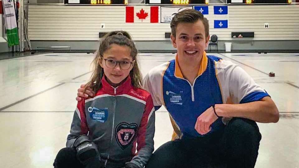 Inuvik curler Pearl Gillis, left, and Alberta partner Karsten Sturmay celebrate following mixed doubles success at the 2018 Canadian Junior Championships - NWT Curling-Facebook