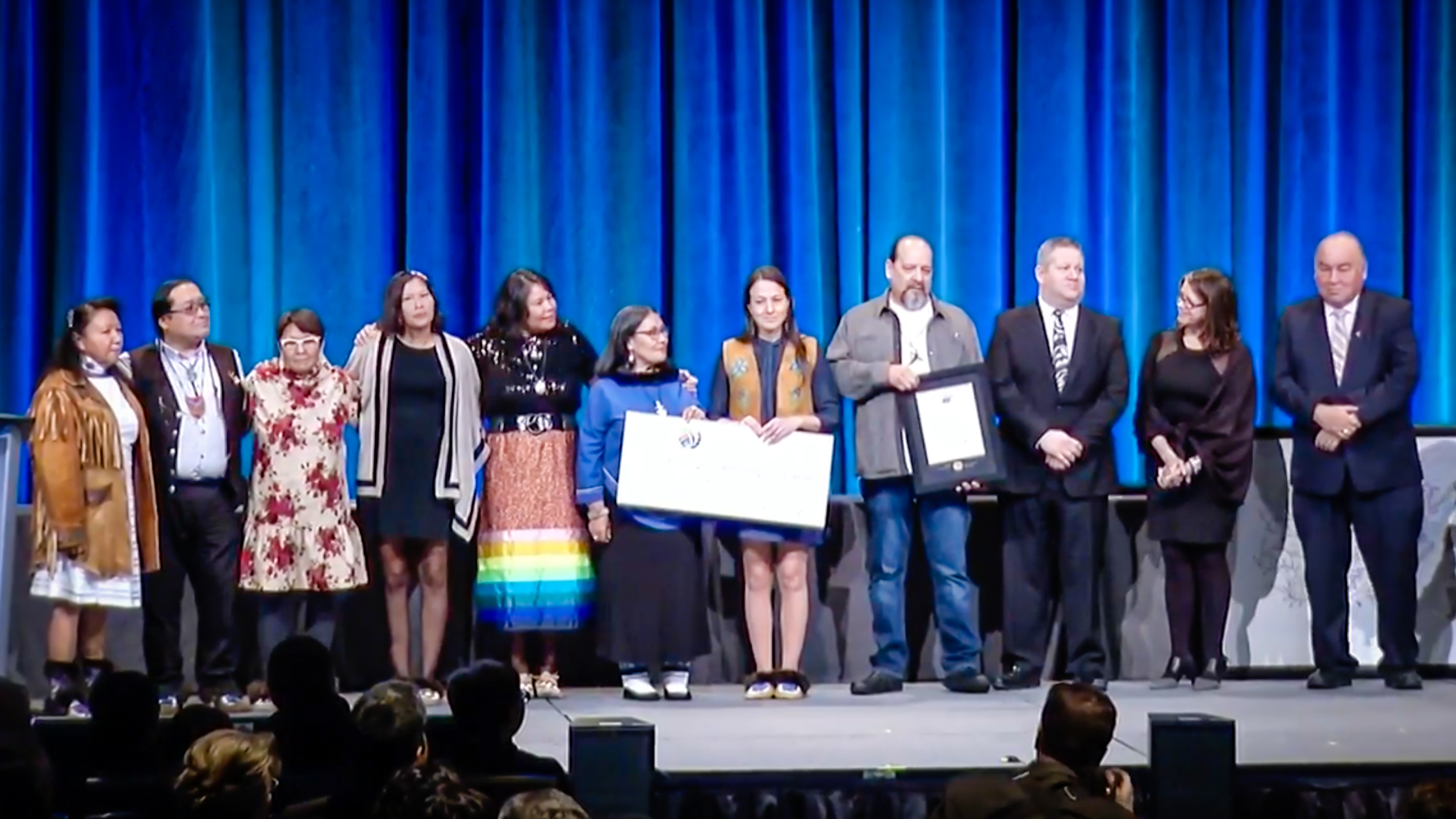 Members of the Arctic Indigenous Wellness Project accept their $1 million Arctic Inspiration Prize in Ottawa on January 31, 2018, alongside Premier Bob McLeod and dignitaries