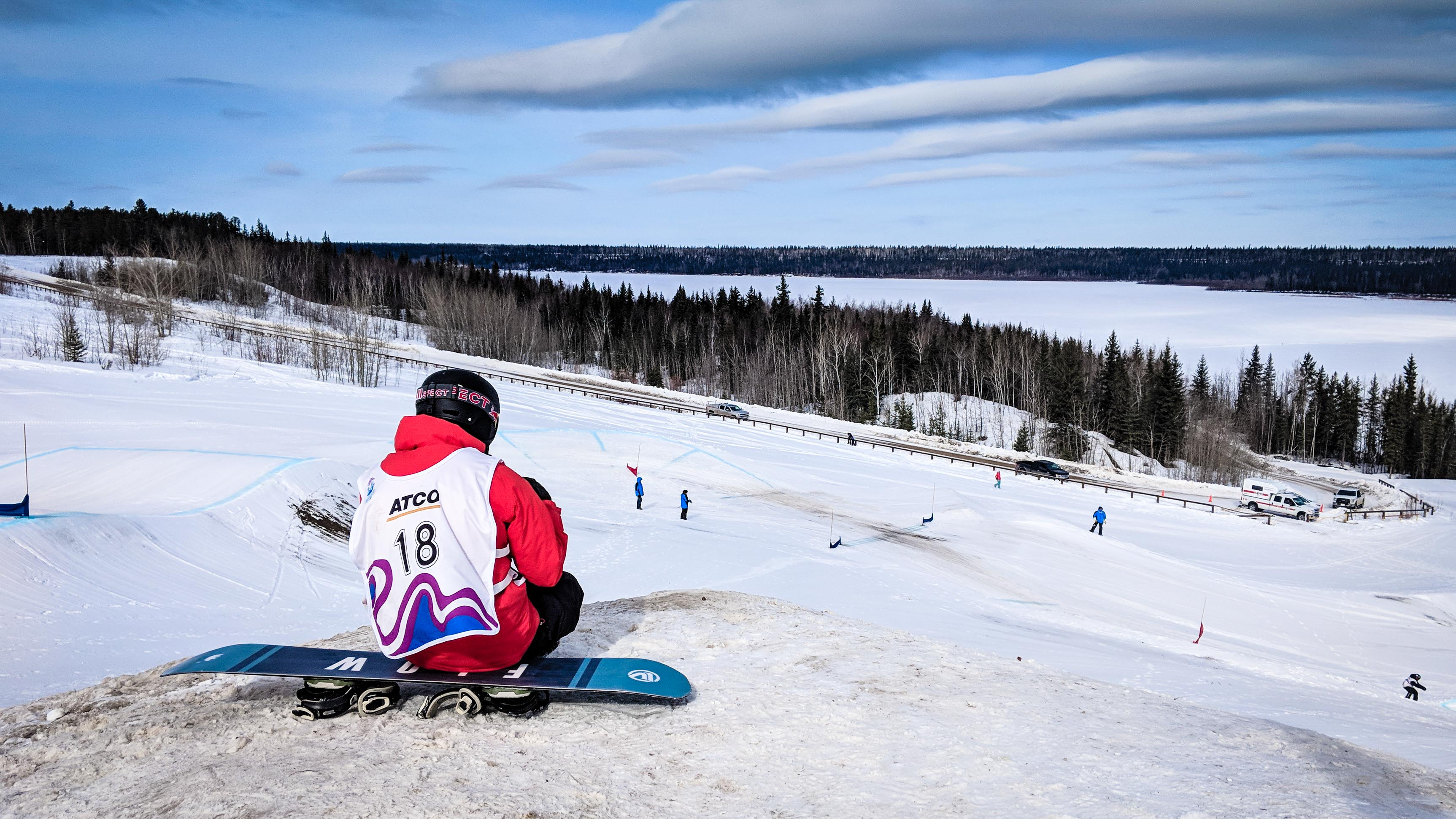 An athlete looks on at the 2018 Arctic Winter Games snowboarding venue in Fort Smith