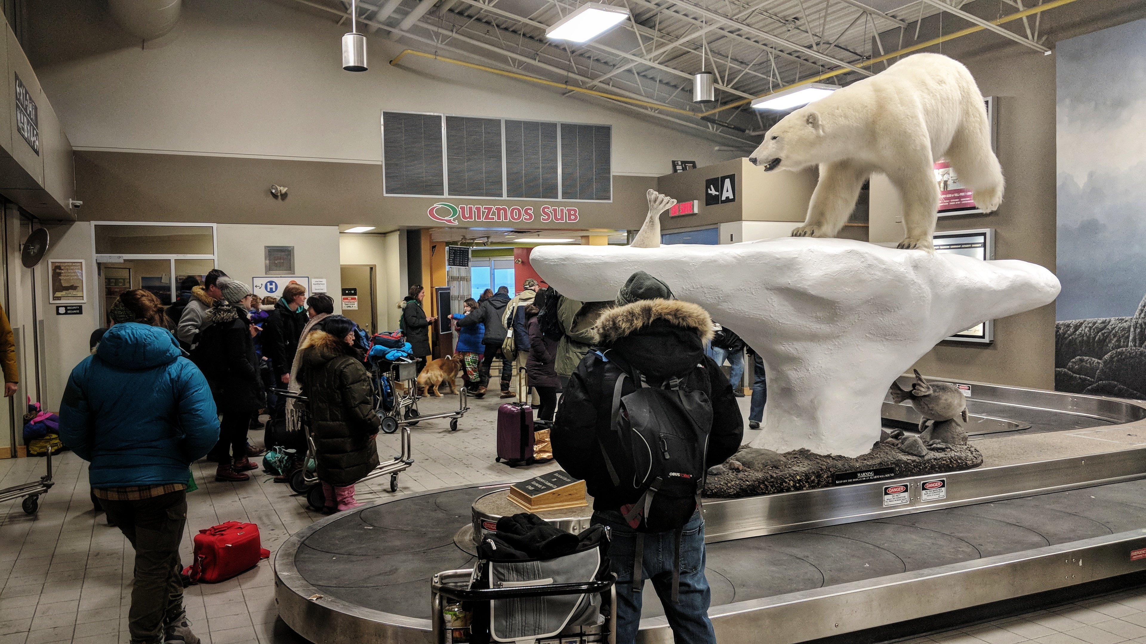 Passengers await their bags at Yellowknife Airport on January 5, 2018