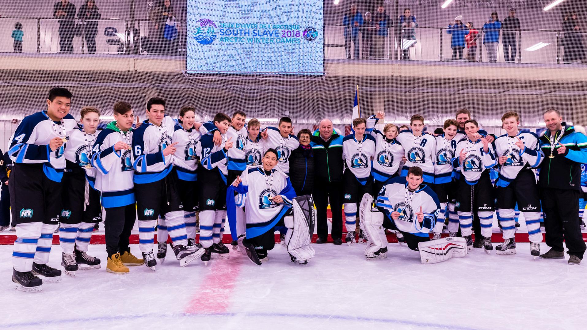 Team NT's bantam hockey players celebrate winning 2018 Arctic Winter Games gold with Premier Bob McLeod - AWG2018-Brian Collins-Landwash Studios