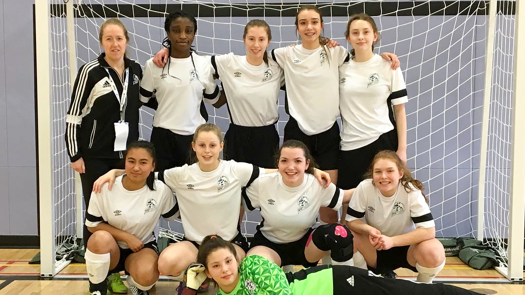 Team NT's junior female futsal players pose for a team photo at the 2018 Arctic Winter Games - NWT Soccer