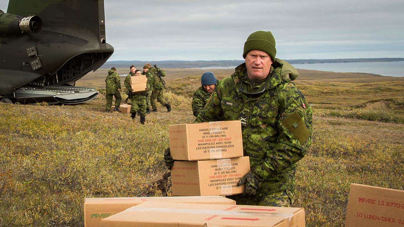Brig-Gen Mike Nixon offloads supplies for troops during 2015's Operation Nanook - Cpl Darcy Lefebvre-Canadian Forces