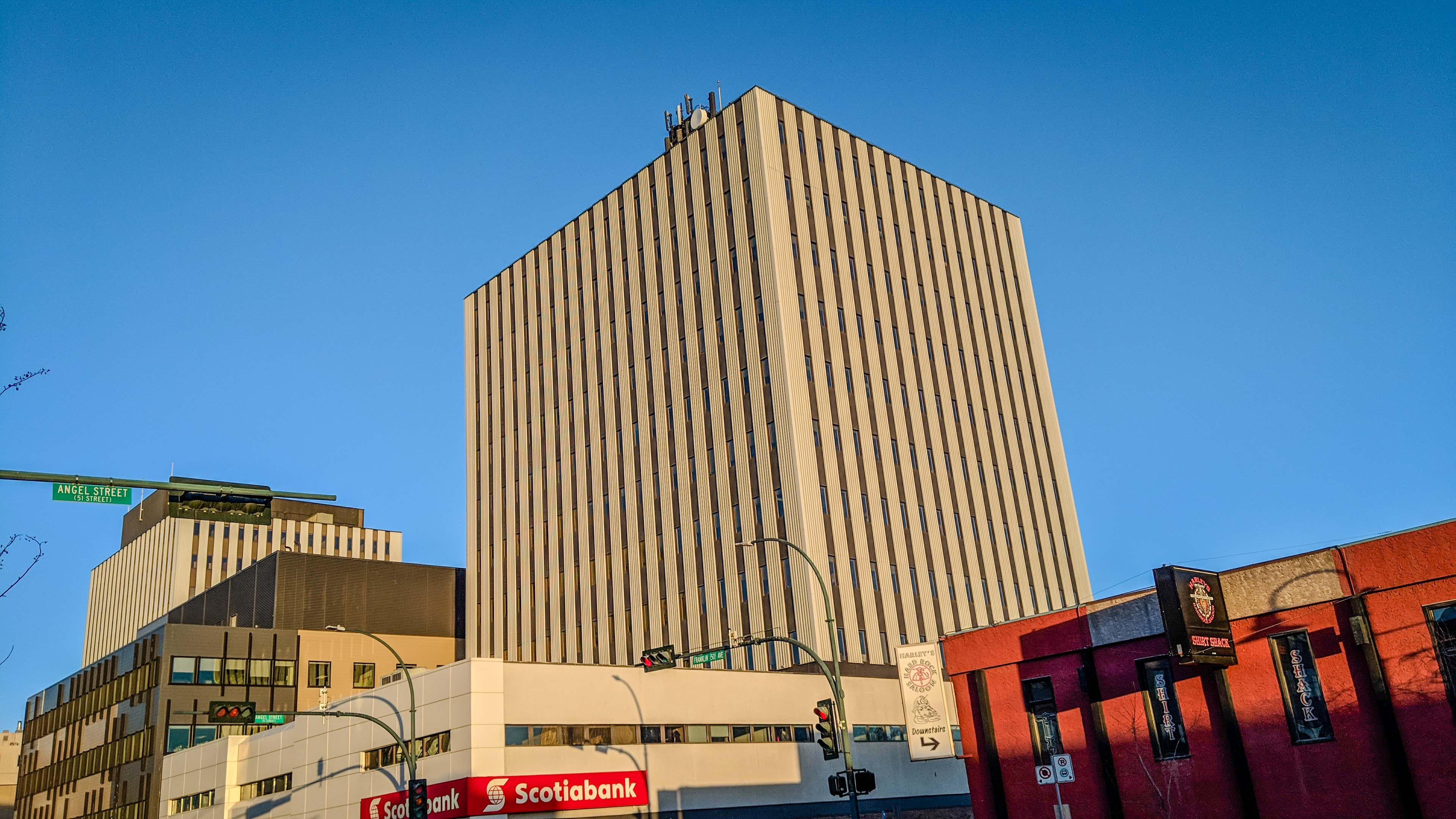 The sun rises over Yellowknife's Scotia Centre, home to several territorial government departments, on the morning of April 26, 2018. Ollie Williams/Cabin Radio