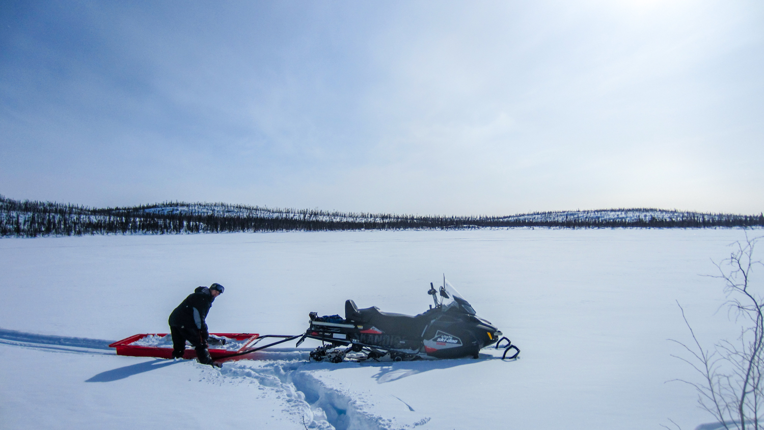 A Wilfrid Laurier researcher conducts a snow survey in the Snare River basin near Wekweeti in the winter of 2018
