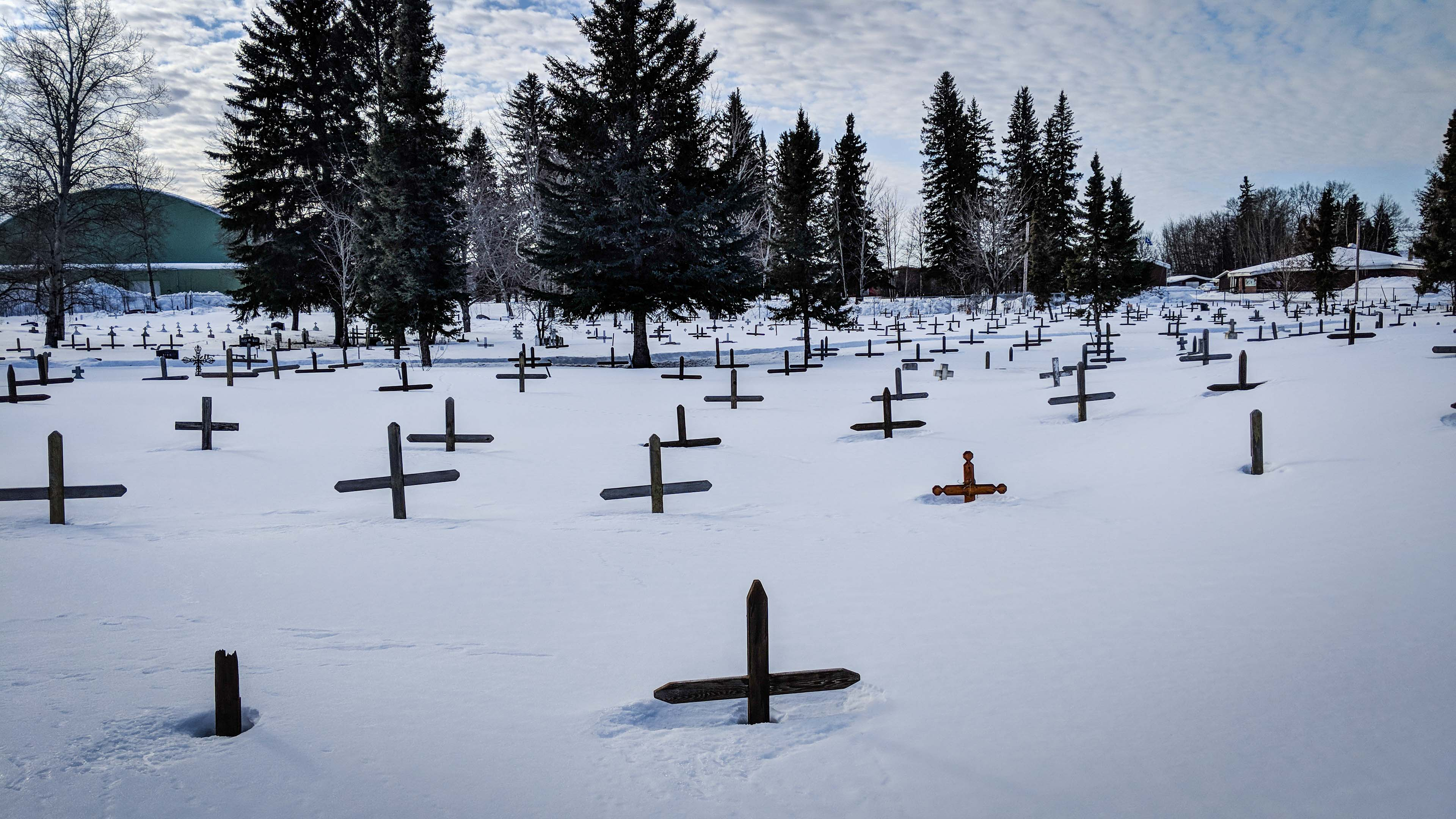 Crosses lie under a blanket of snow at a Fort Smith graveyard in March 2018