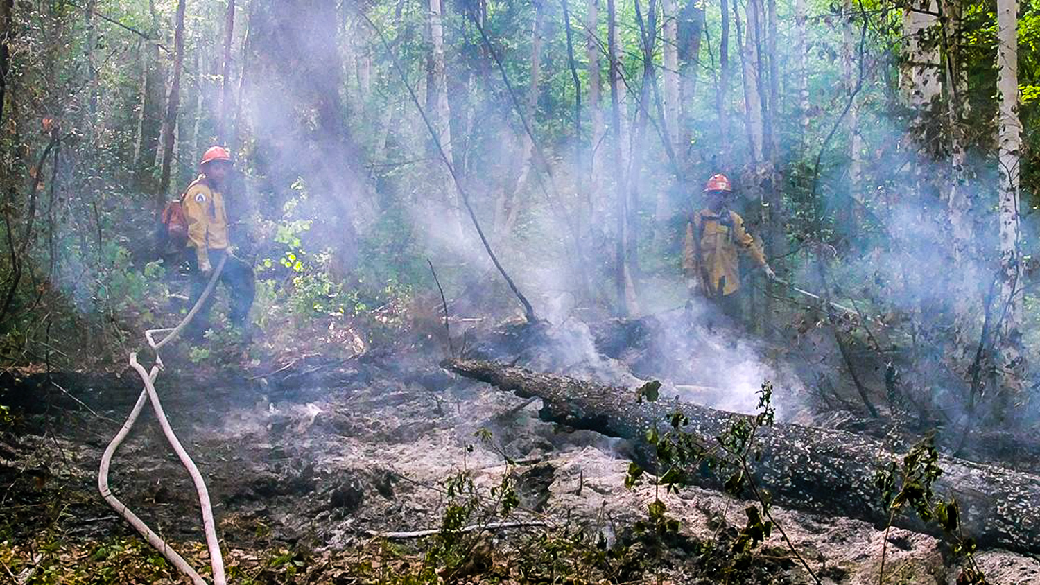 NWT firefighters tackle a wildfire burning south of Fort Liard in May 2018