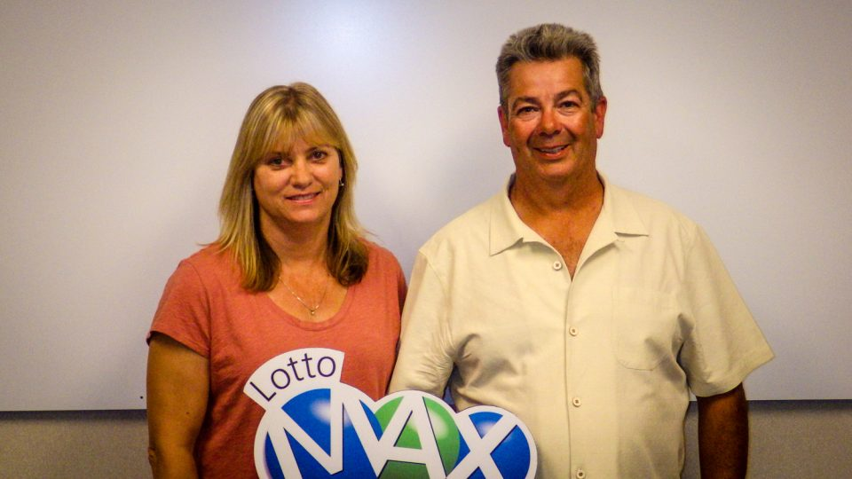 Bradley and Janice McNeill pose in a Western Canada Lottery Corporation handout image following their $1M win