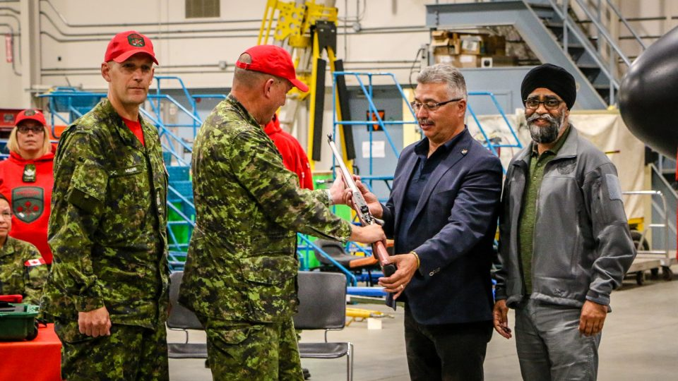 Canada's defence minister gave no timeline for replacing four ageing Yellowknife-based Twin Otters as he arrived in the city to help hand over new rifles.