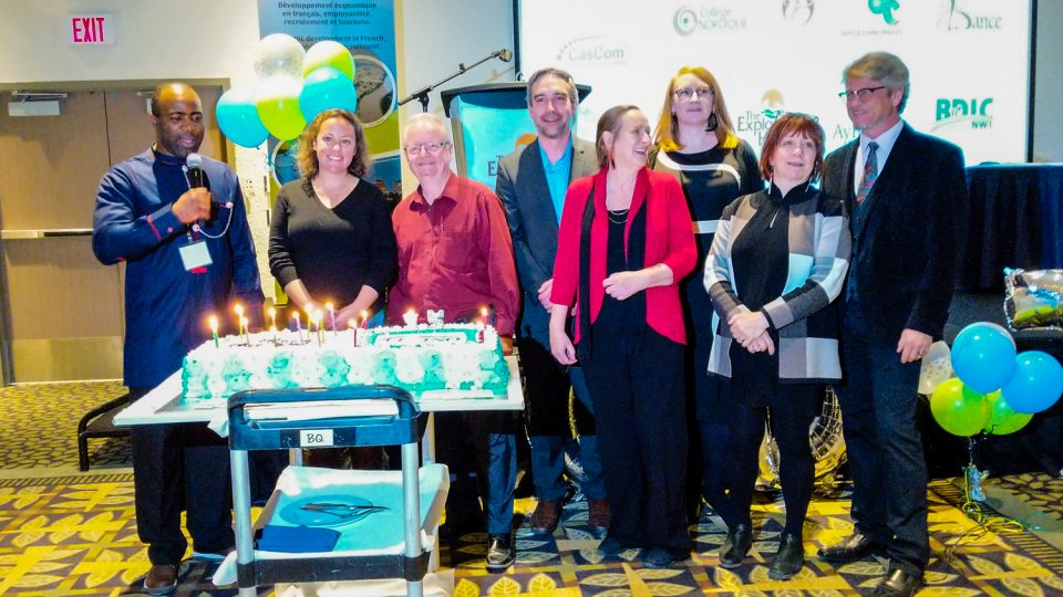 Dignitaries at CDETNO's 15th anniversary celebrate with a birthday cake