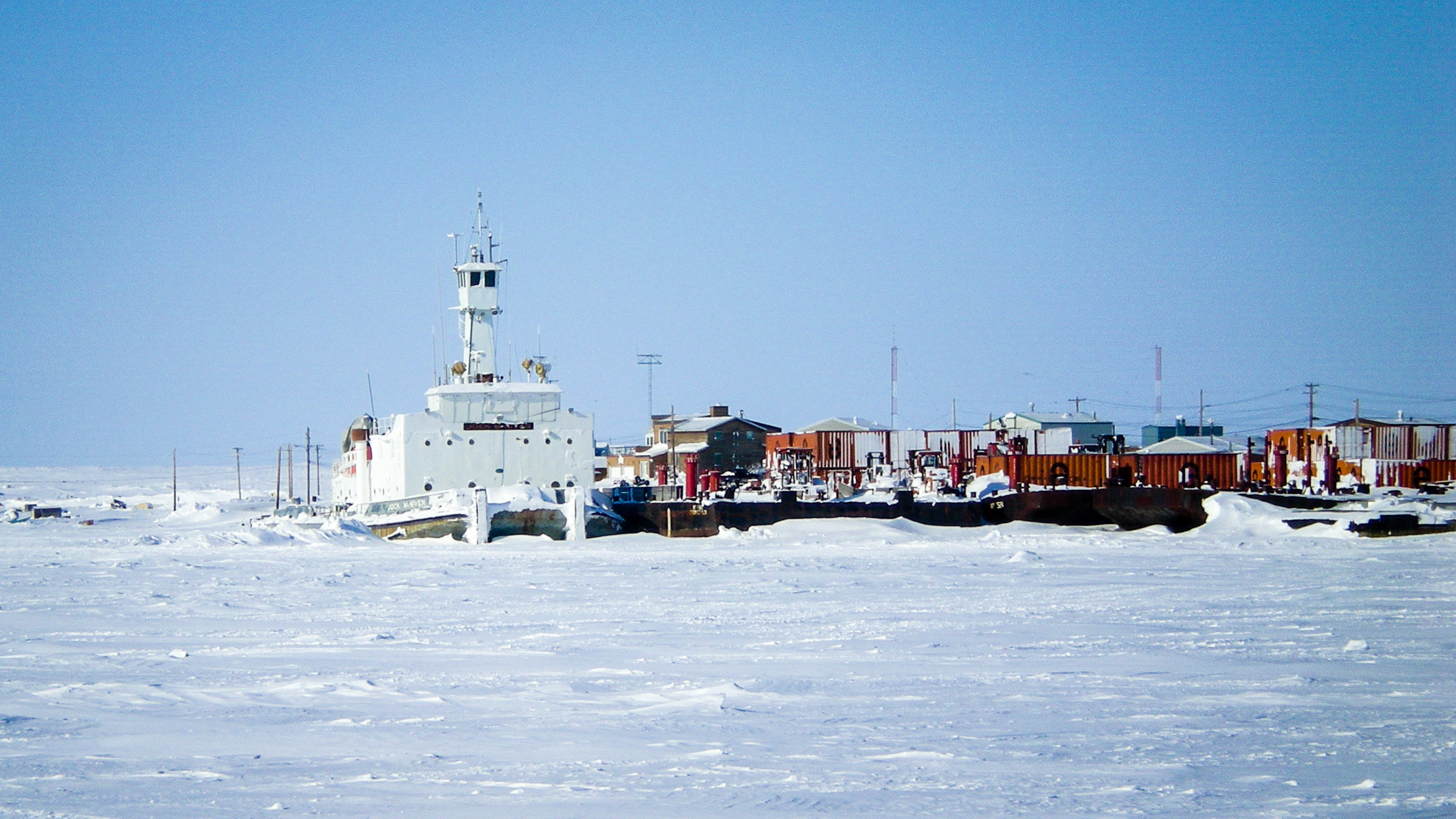 A barge, operated at the time by NTCL, is pictured overwintering in Cambridge Bay in 2008