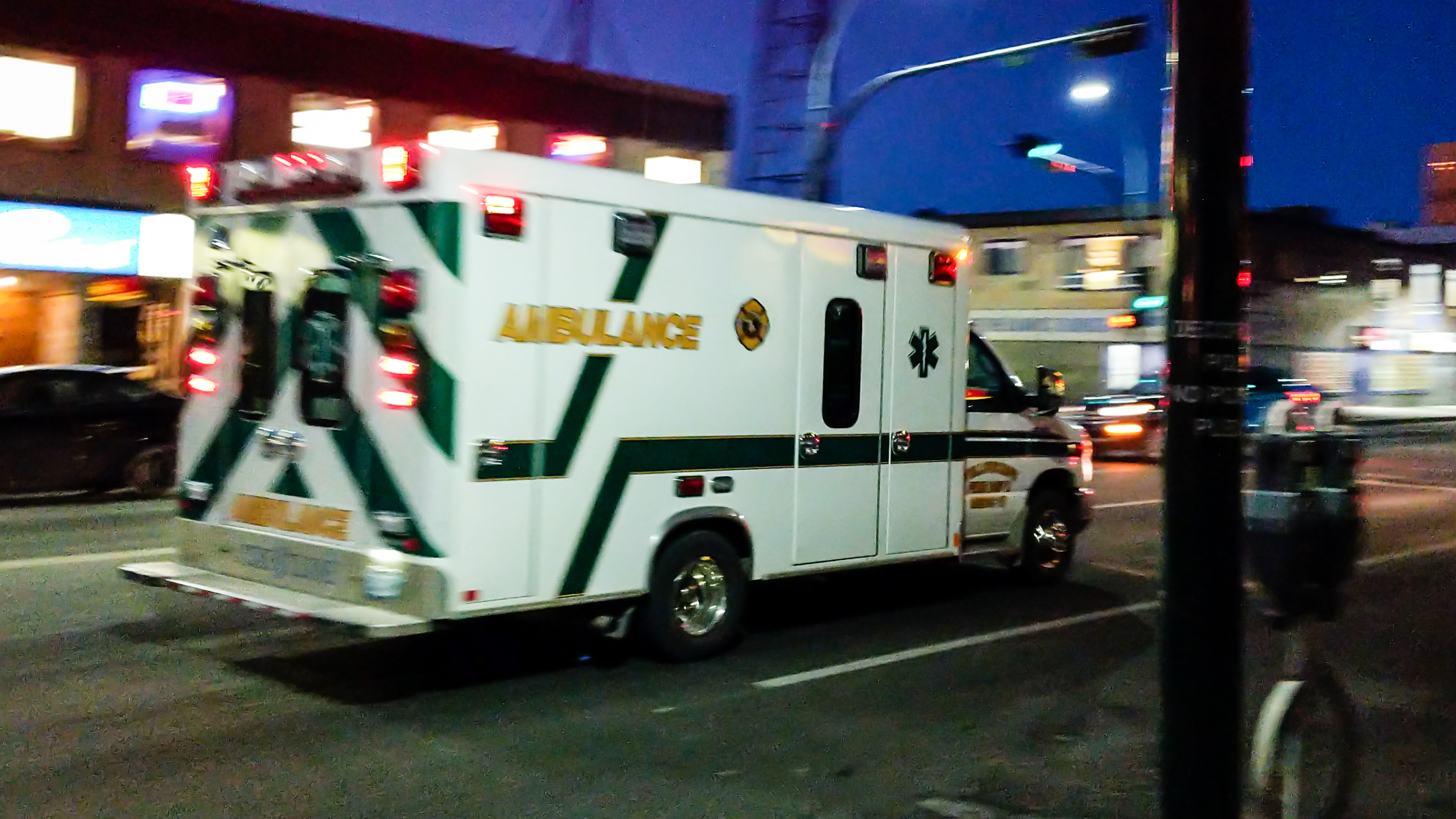 An ambulance makes its way down Yellowknife's Franklin Avenue in October 2018
