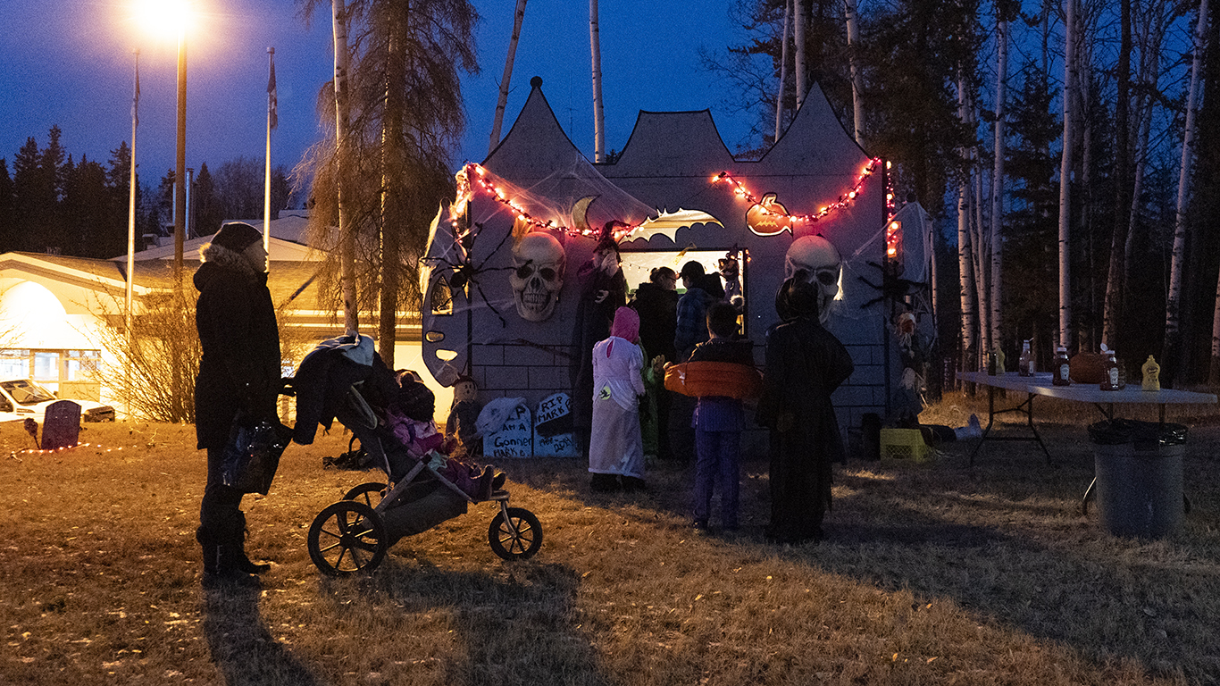 Trick-or-treaters line up outside the Fort Smith Correctional Complex's haunted castle for hot dogs, hot chocolate, and candy. Sarah Pruys/Cabin Radio