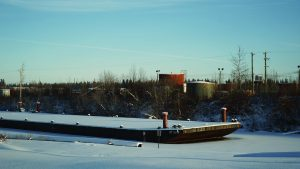 A file photo of a barge in Hay River in November 2018. Sarah Pruys/Cabin Radio