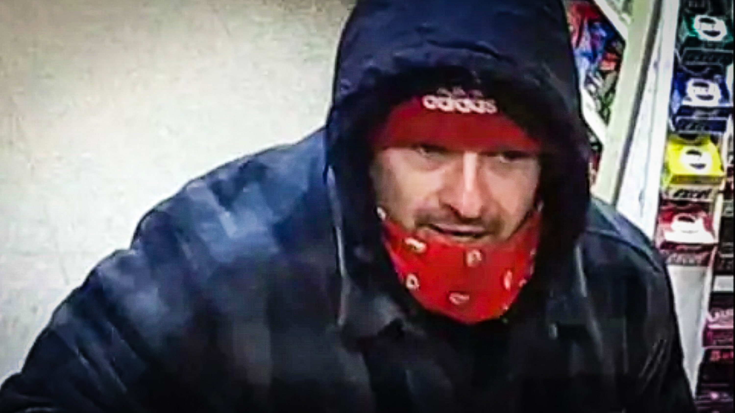 A suspect in a Reddi Mart robbery in January 2018 is shown in a still from security footage released by RCMP at the time