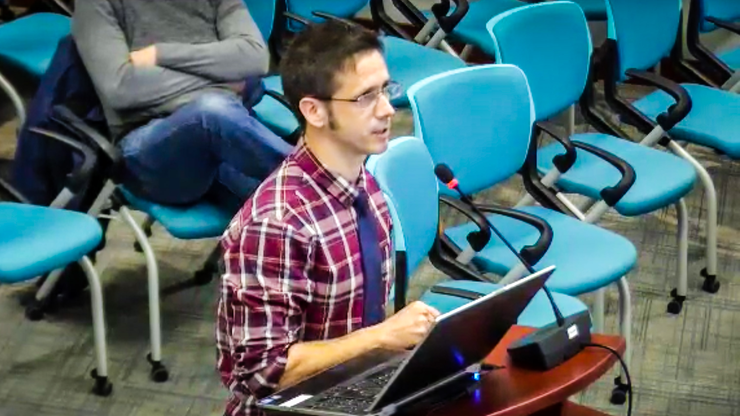 John Mutford, from Yellowknife's public library, presents to councillors on January 21, 2019
