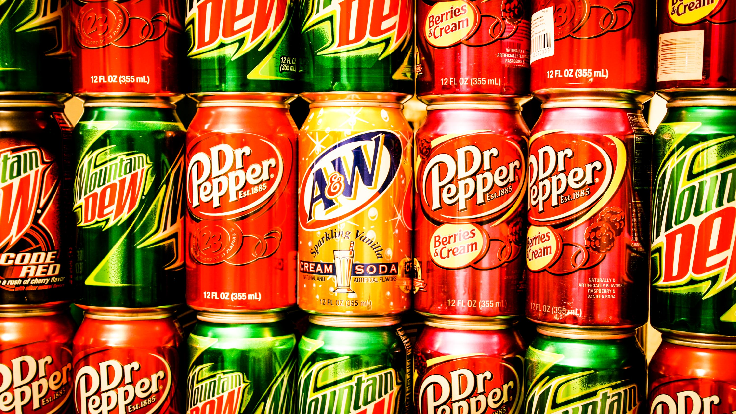Soft drink cans are shown on store shelves in a file photo