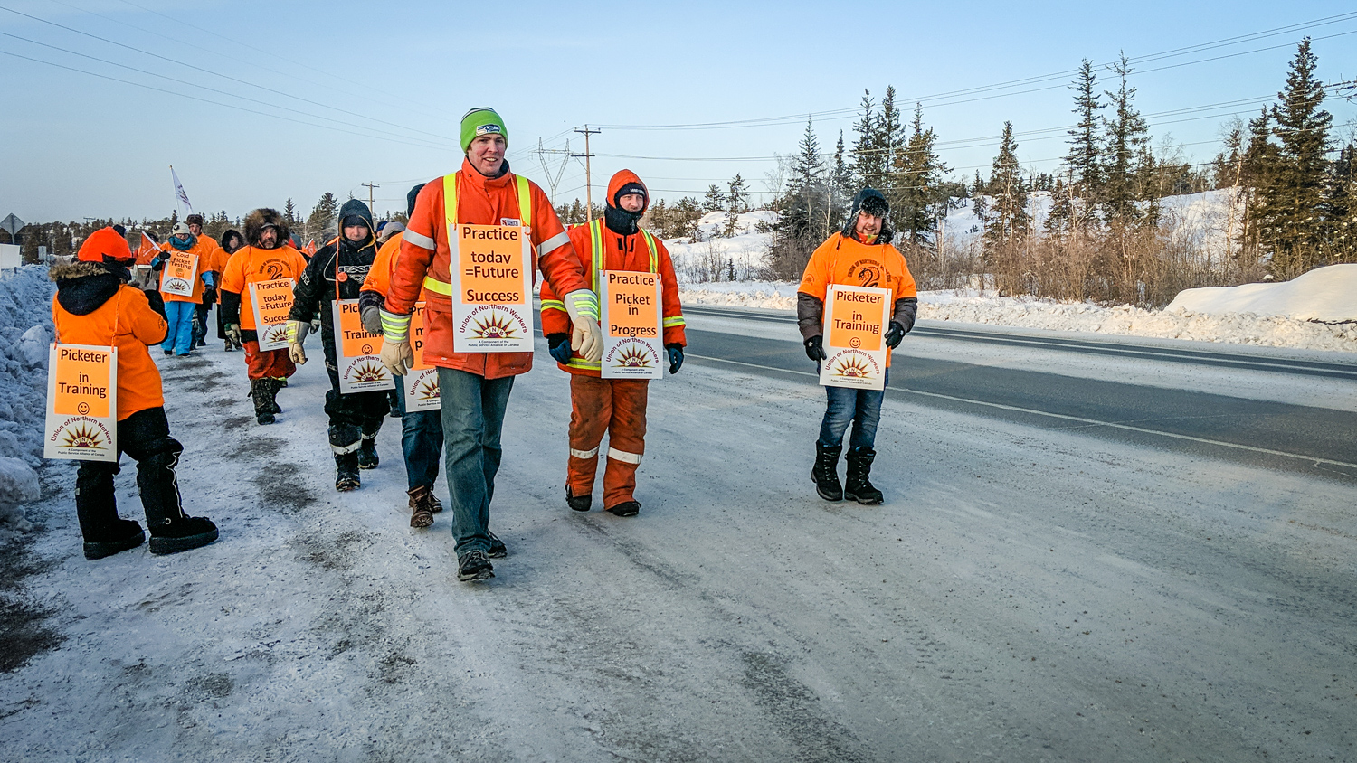 Union of Northern Workers members stage a 'practice picket' outside the Jackfish Lake power plant in Yellowknife in December 2018