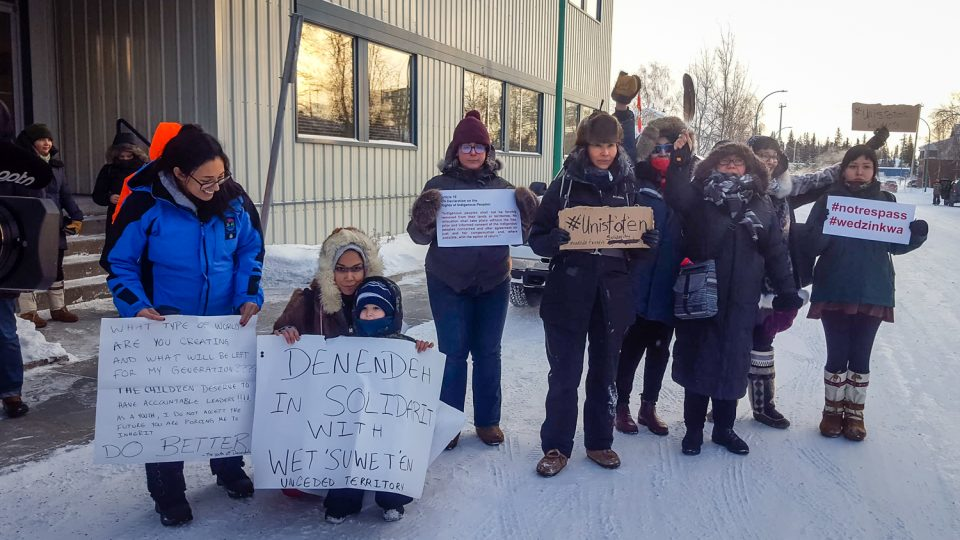 Yellowknife residents display solidarity with anti-pipeline protesters outside the office of NWT MP Michael McLeod