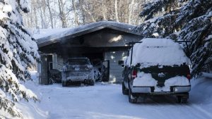 A car and garage fire was quickly extinguished on 203 McDougal Road in Fort Smith on February 4, 2019. Sarah Pruys/Cabin Radio