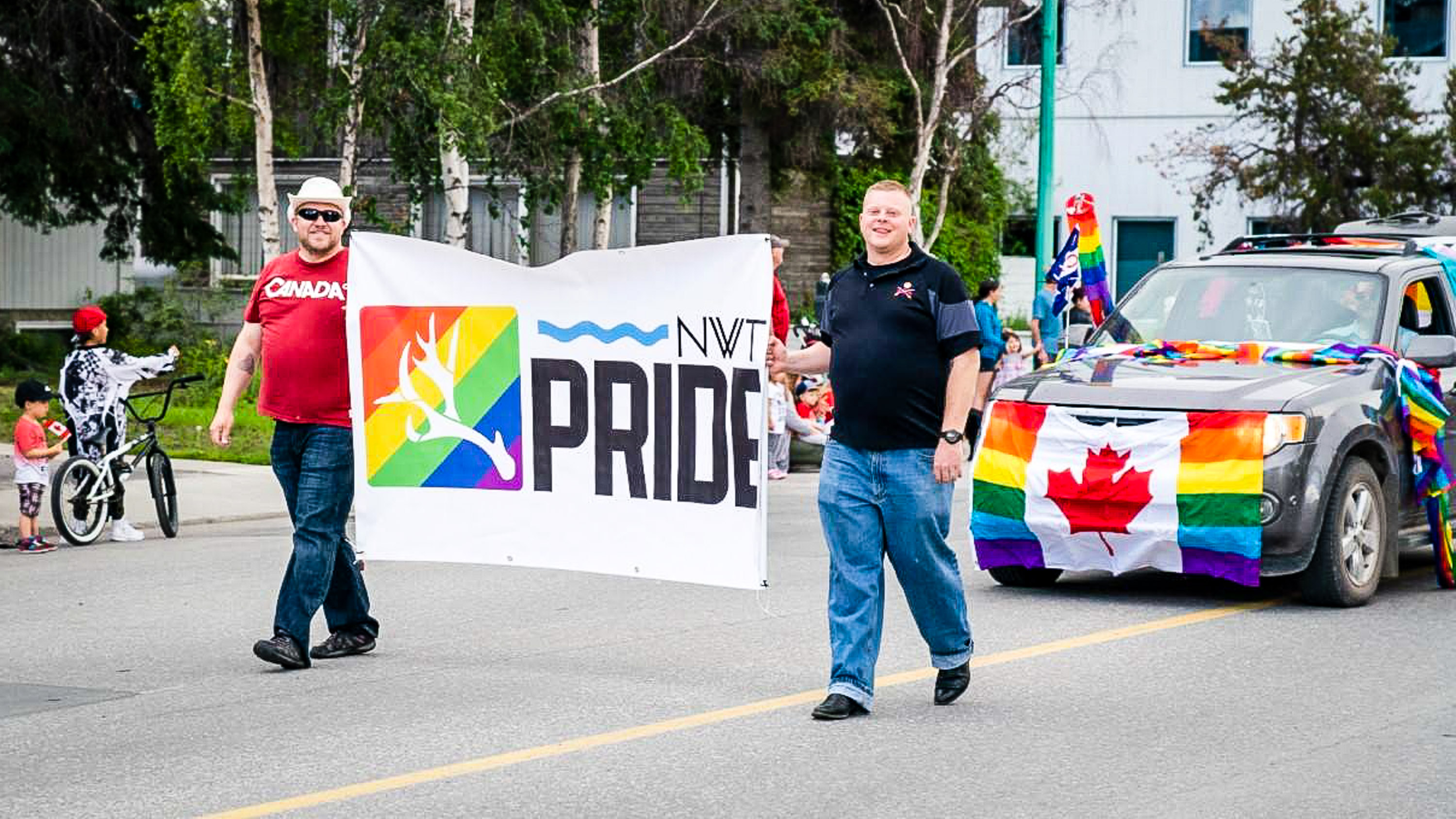 A photo posted online by NWT Pride shows its banner being carried by supporters during a parade in 2018