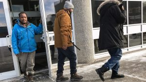 A photograph taken outside Yellowknife's courthouse shows some of those who heard details in court regarding the death of cab driver Ahmed Mahamud Ali