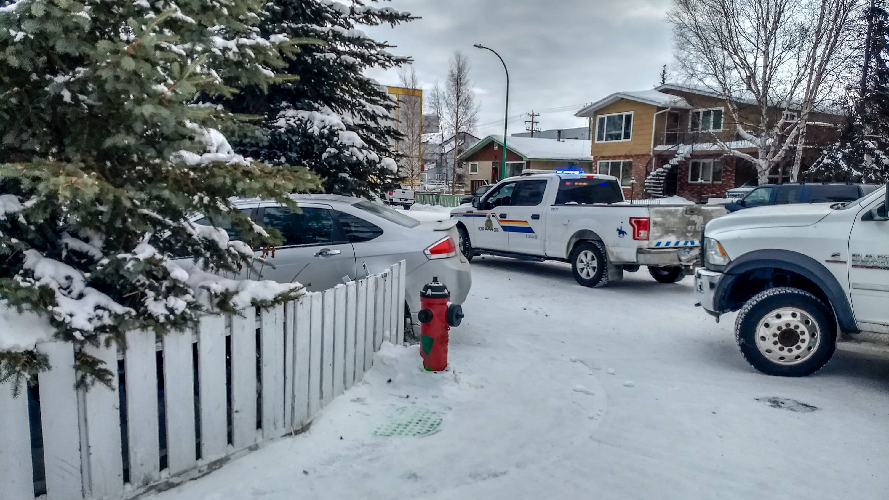 A vehicle off the road in downtown Yellowknife in February 2019 is seen next to an RCMP vehicle