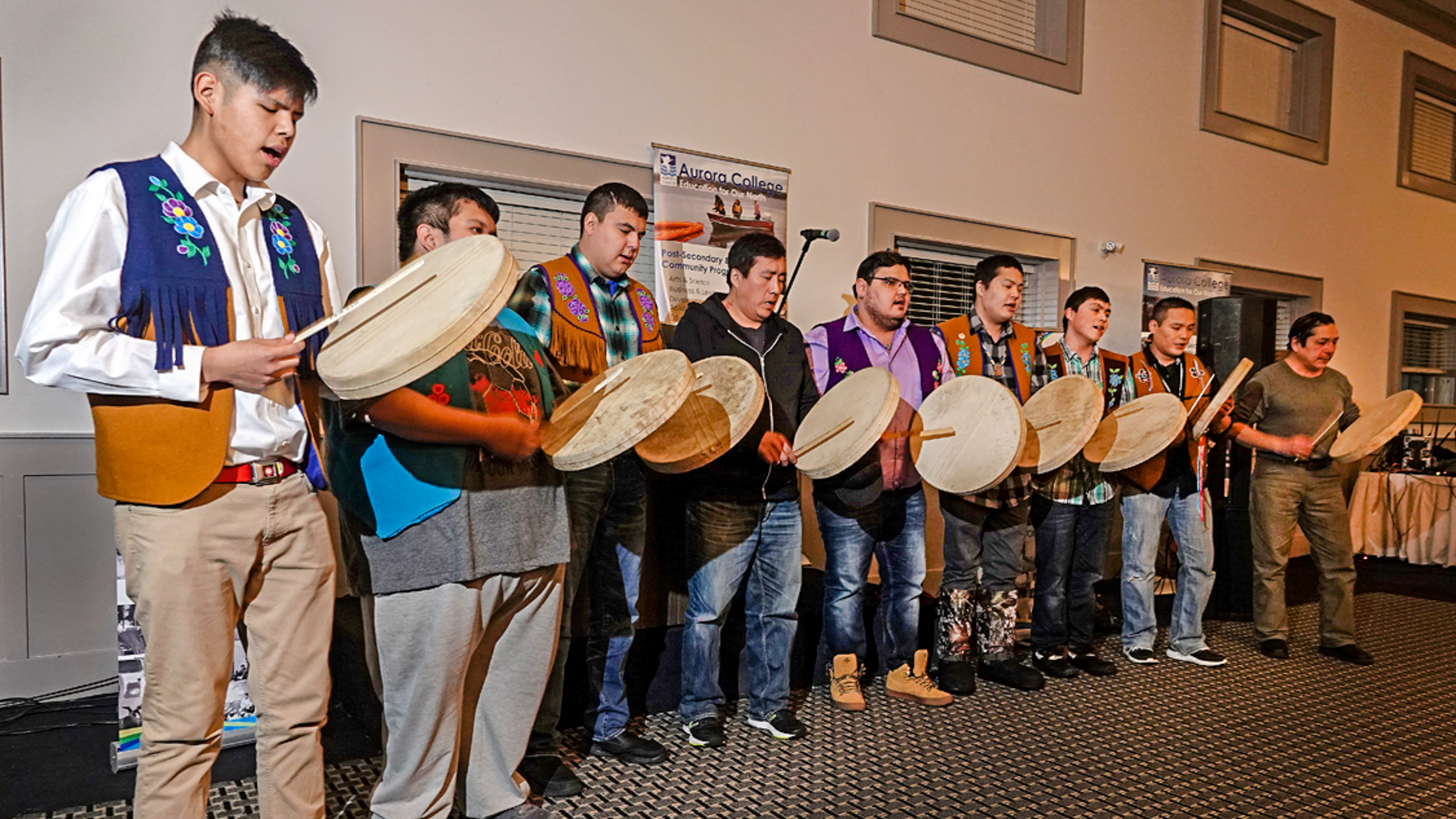 The Yellowknives Dene Drummers perform last week at the college's reunion and celebration.