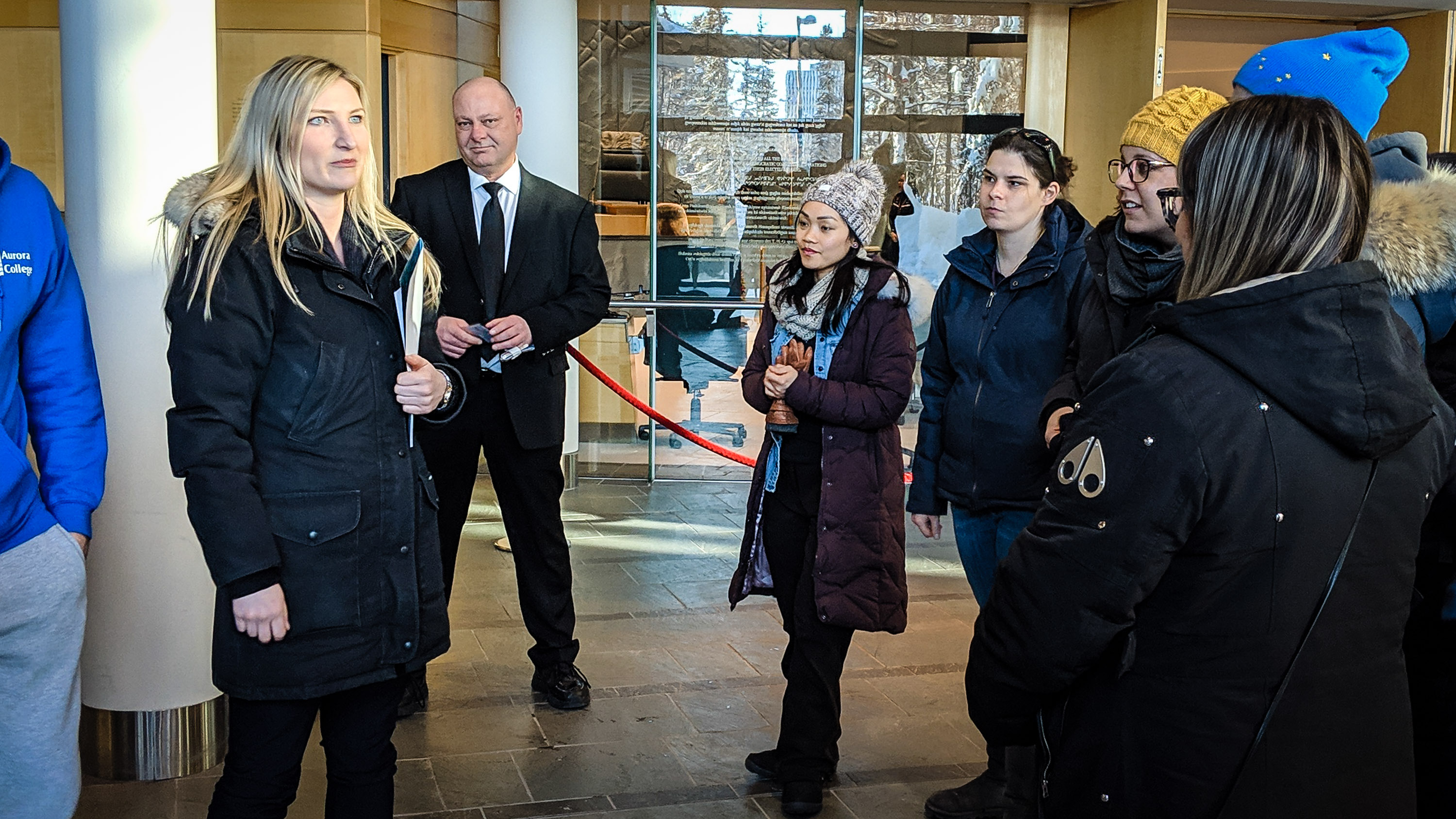 Samantha Morandin, left, leader of Aurora College's student association, waits at the NWT legislature to lobby MLAs for a resolution to looming strike action