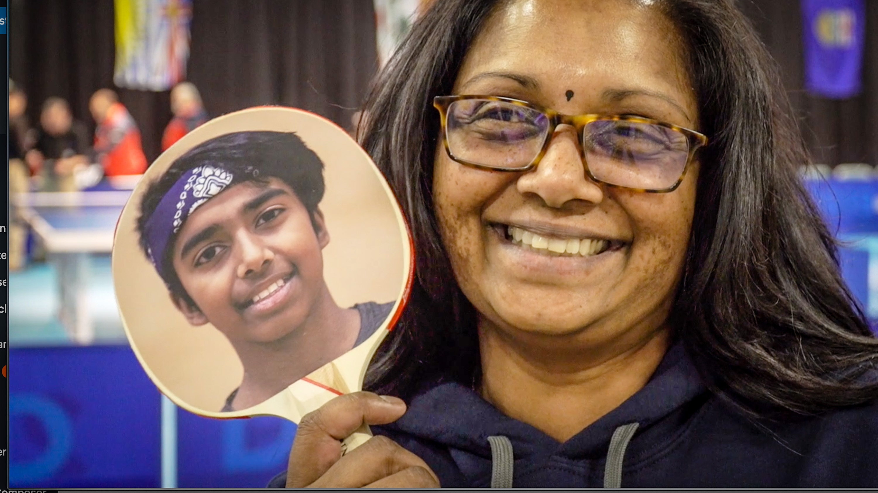 Suraiya Naidoo poses with an image of her son's face on a table tennis racket