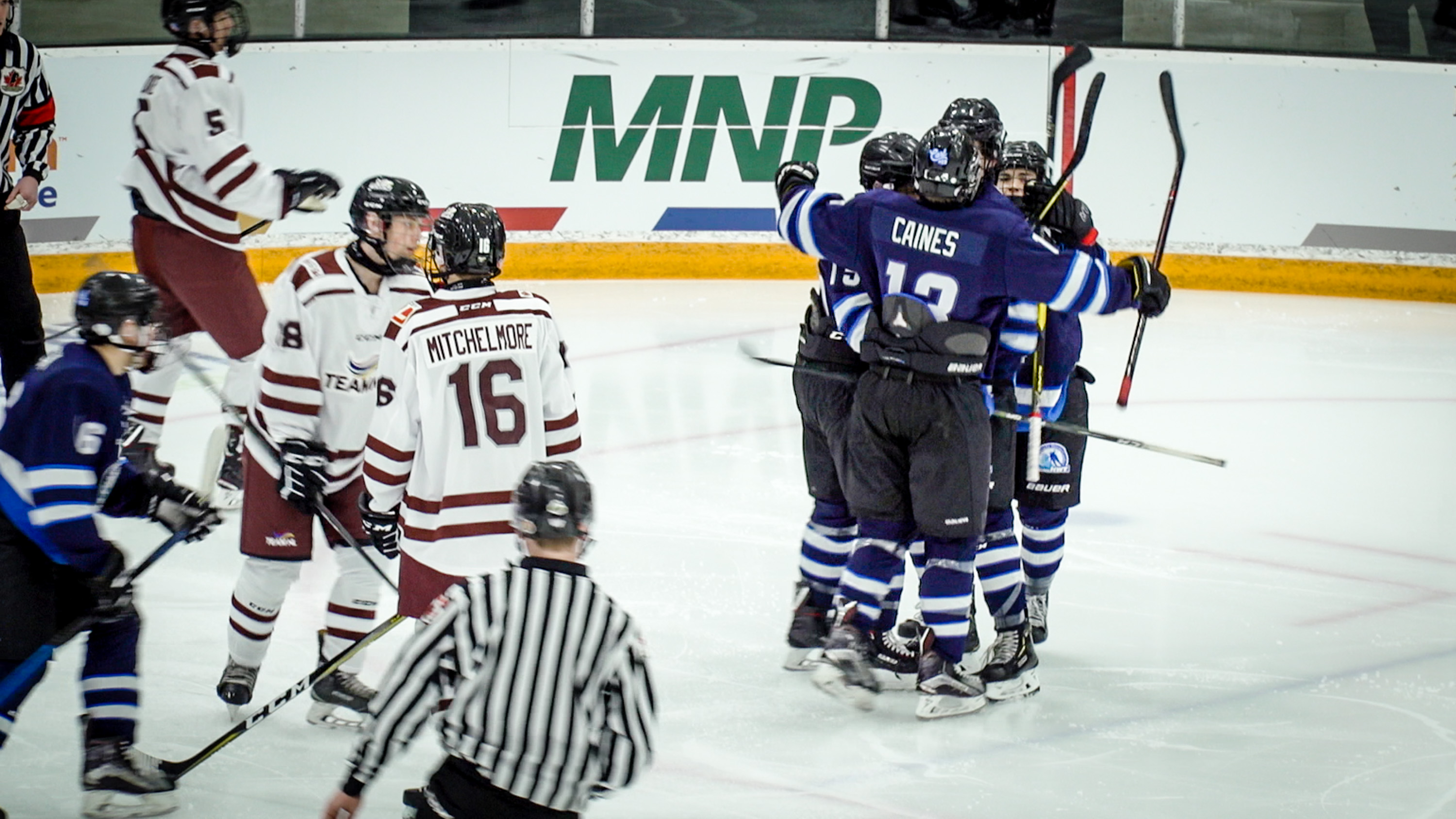Team NT players celebrate scoring a goal against Team NL at the 2019 Canada Games