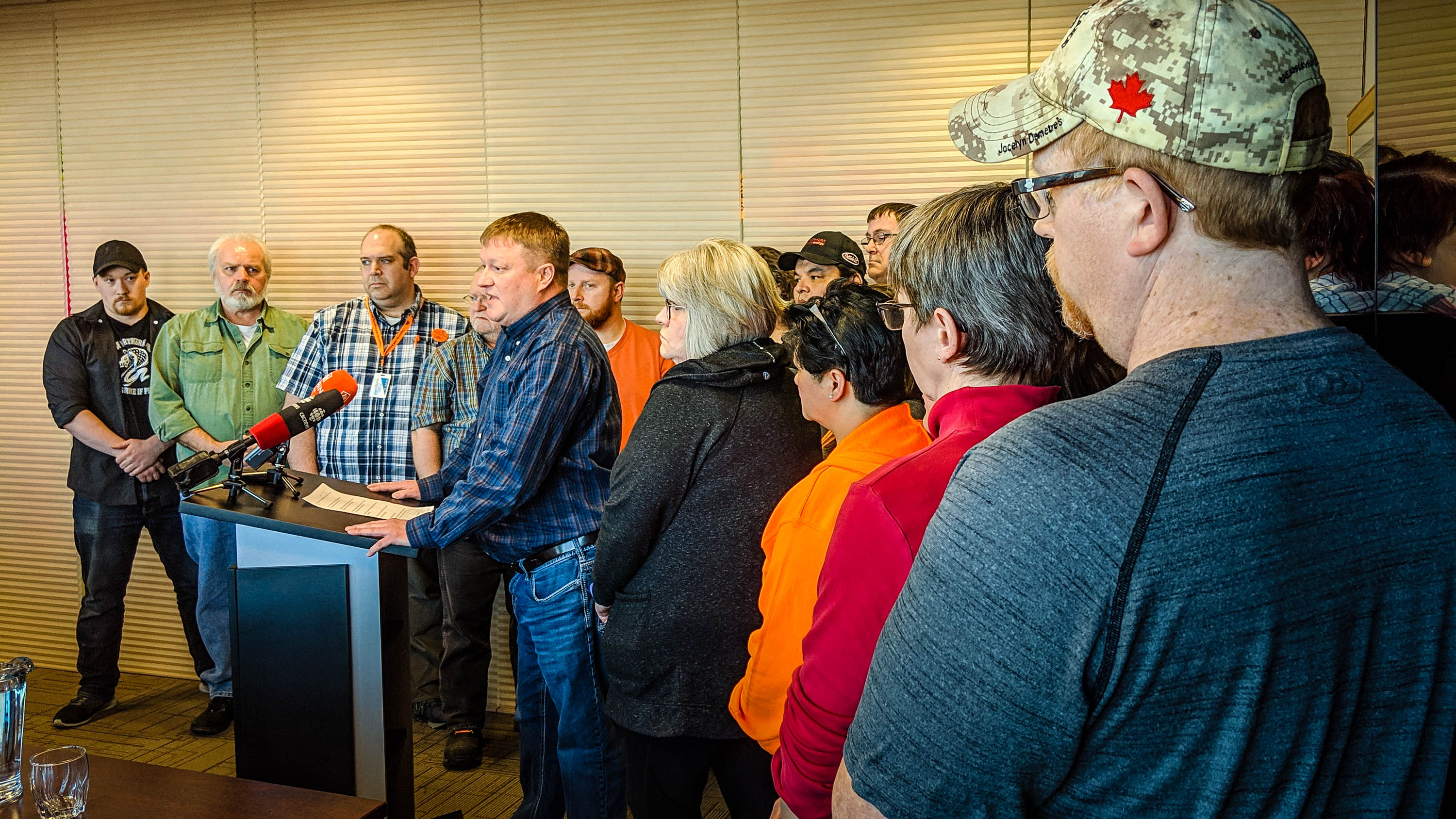Todd Parsons, union leader, addresses reporters flanked by union local leaders at a news conference on February 5, 2019