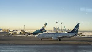 A file photo of WestJet planes at the Calgary airport in March 2019. Sarah Pruys/Cabin Radio
