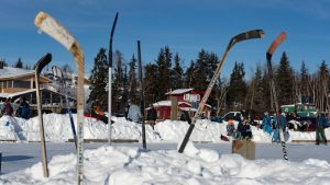 A file photo of hockey sticks at the Snow King Cup pond hockey tournament in March 2019. Sarah Pruys/Cabin Radio