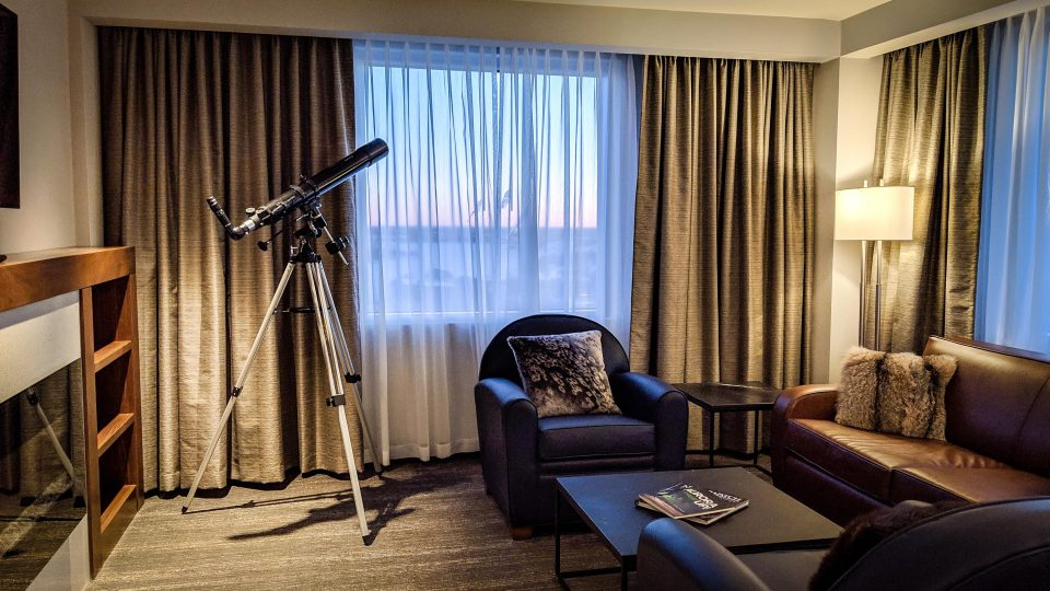 A telescope in the living room of the Explorer Hotel's Aurora Suite