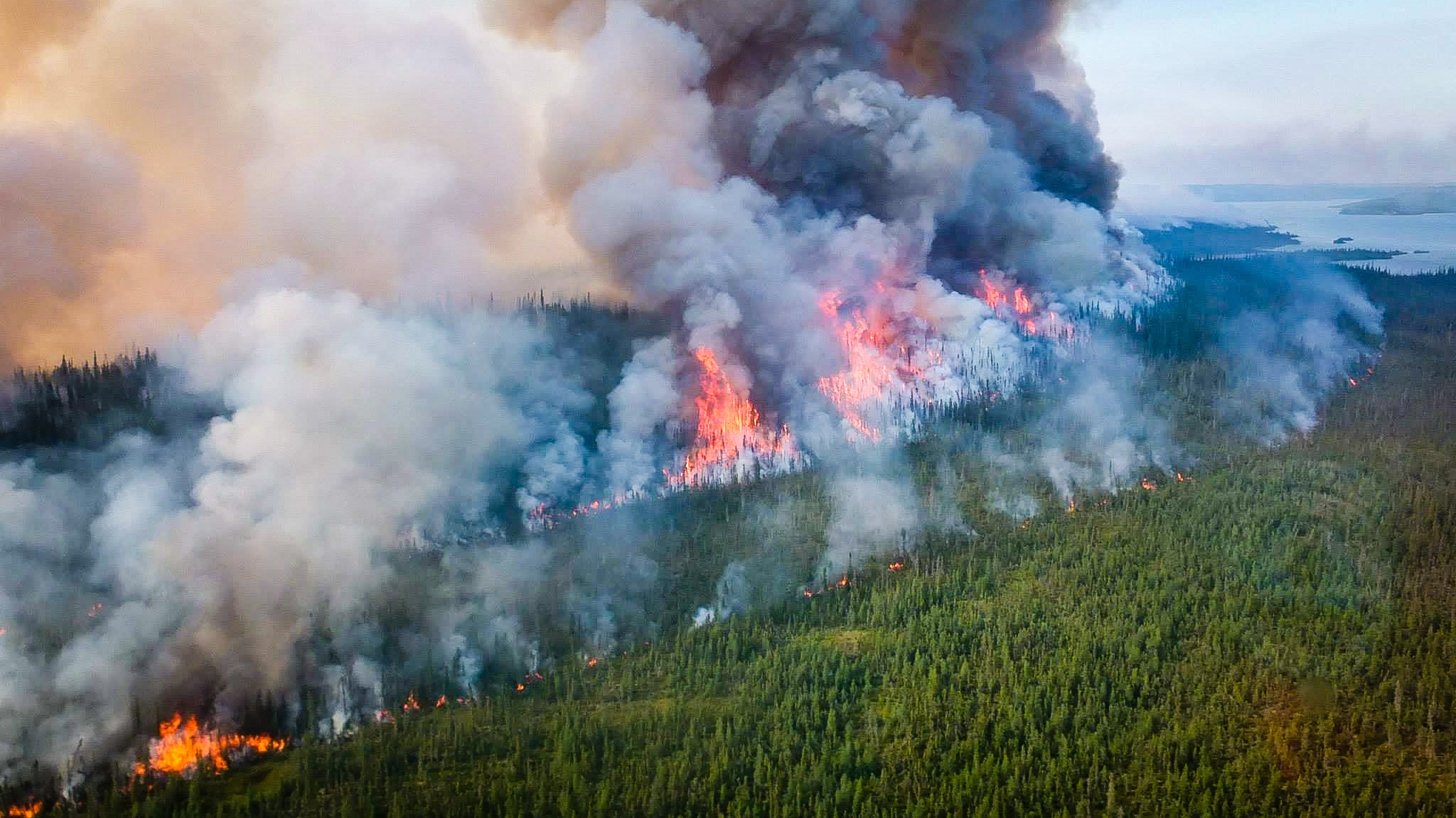 A territorial government photo shows a prescribed burn operation at Plummers Lodge during the 2014 wildfire season