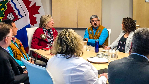 Carolyn Bennett, centre left, meets community leaders during a visit to the NWT in March 2019