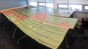 Inuvik RCMP display $69,000 in cash they found while executing a search warrant.
