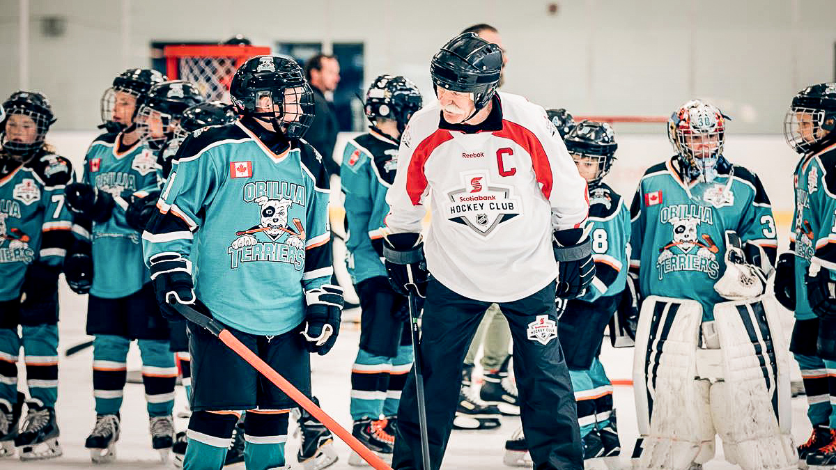 Lanny McDonald coaches young hockey players in Orillia during a Hockey Day in Canada event in 2018