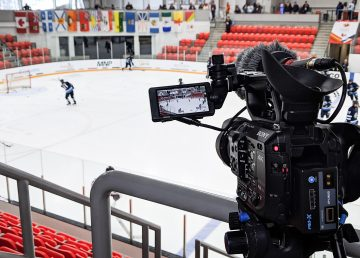 A television camera broadcasts a hockey game involving Team NT at the 2019 Canada Winter Games