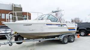 A file photo of an RCMP boat. Sarah Pruys/Cabin Radio