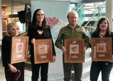 The four winners of 2019's Outstanding Volunteer Awards pose at the legislature