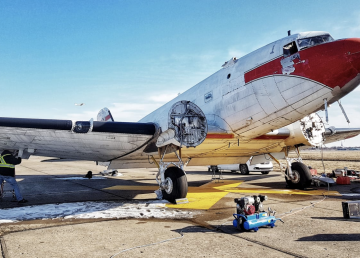 A Douglas DC-3 that flew on D-Day is worked on by Mikey McBryan and crew in readiness for a 75th-anniversary memorial flight
