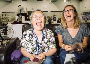 Two participants at the 2016 Great Northern Arts Festival share a laugh