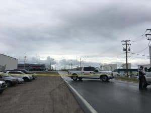 Police vehicles close off a road near Yellowknife Airport
