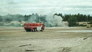 A fire truck attends a burning vehicle at Yellowknife's sandpits on July 9, 2019