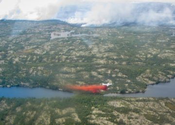 A tanker drops fire retardant on wildfire ZF-024, northwest of Yellowknife, in July 2019