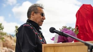 Felix Lockhart leads a fire feeding ceremony at the grand opening of the new Stanton Territorial Hospital in July 2019. Sarah Pruys/Cabin Radio