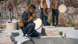 An NWT Drummer takes part in a fire feeding ceremony at the opening of the new Stanton Territorial Hospital in July 2019. Sarah Pruys/Cabin Radio