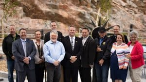 Dignitaries pose in front of Derrald Taylor and Ali Nasogaluak's sculpture, Qulliq, at the opening of the Stanton Territorial Hospital in July 2019. Sarah Pruys/Cabin Radio